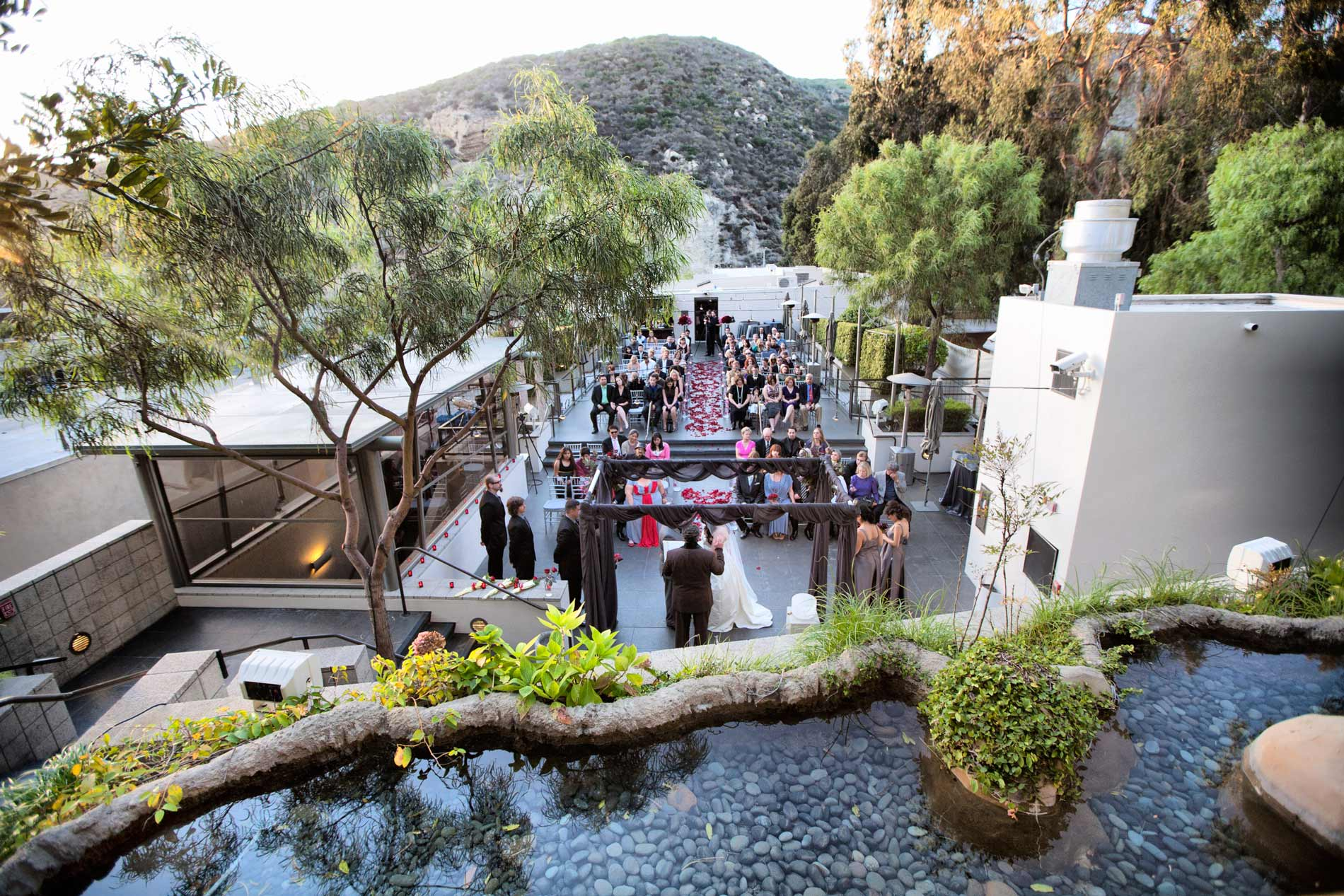 an outdoor wedding in orange county on the terrace of seven
